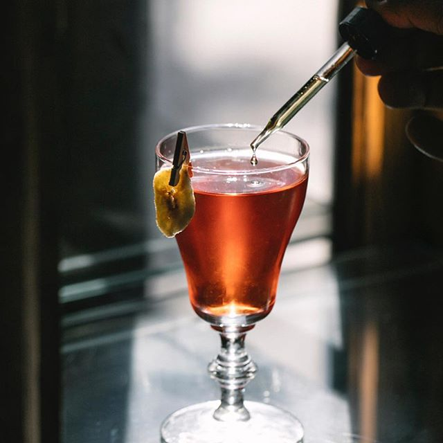 Putting the finishing touches on a specialty negroni as photographed by @shannonshootscocktails - - - #details #sesameoil #bitterisbetter