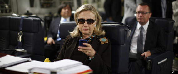 The now famous image of Hillary Clinton on her phone.
