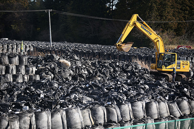 Radiation-contaminated debris and soil is stockpiled for disposal near the Tokyo Electric Power Company's embattled Fukushima Daiichi nuclear power plant on February 25, 2016, in Okuma, Japan. (Photo: Christopher Furlong / Getty Images)