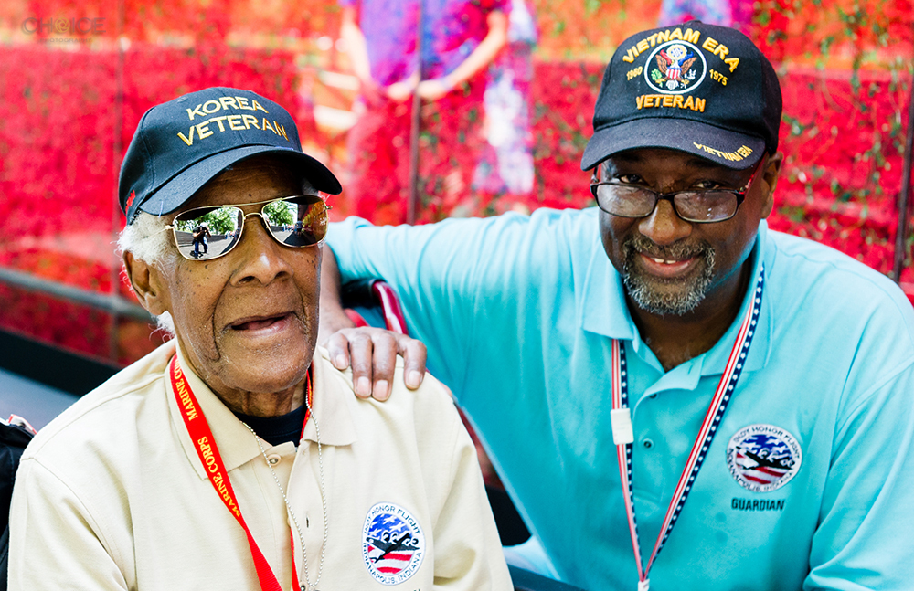 Honor Flight recipient and his guardian at The Poppy Memorial at National Mall on May 26, 2018 in Washington, D.C. (Photo by Rodney Choice/AP Images for USAA)