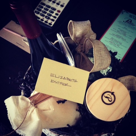 Gift basket: wine, bath salts, candle, chocolate and a Christmas tree ornament. Sooo amazing.