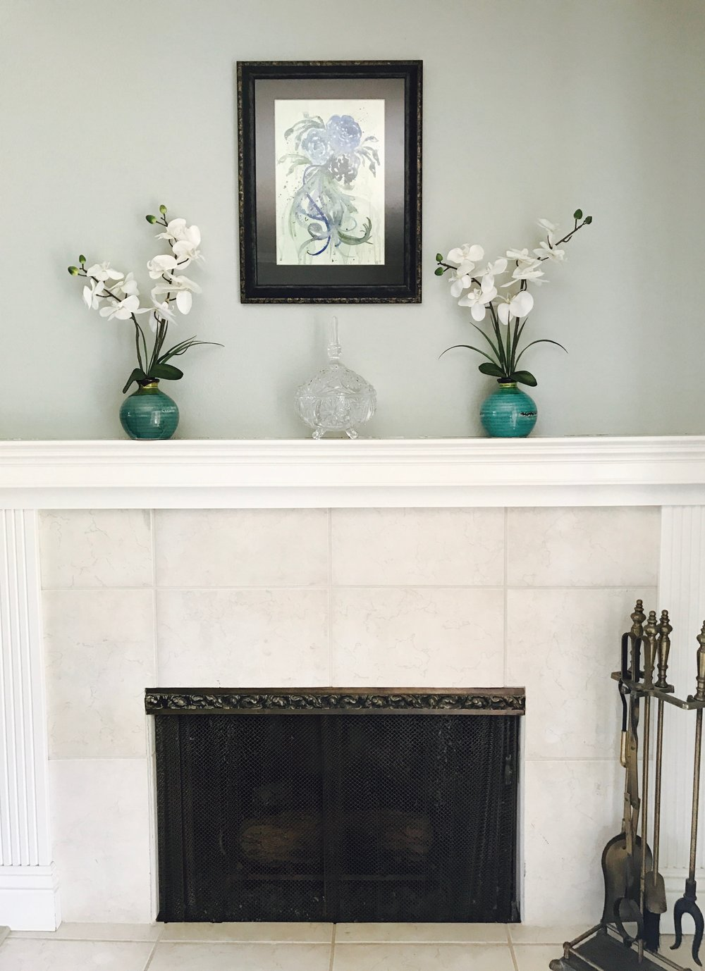 "My living room fireplace with my original artwork, ""Blue Roses."" I love this little area of my home."