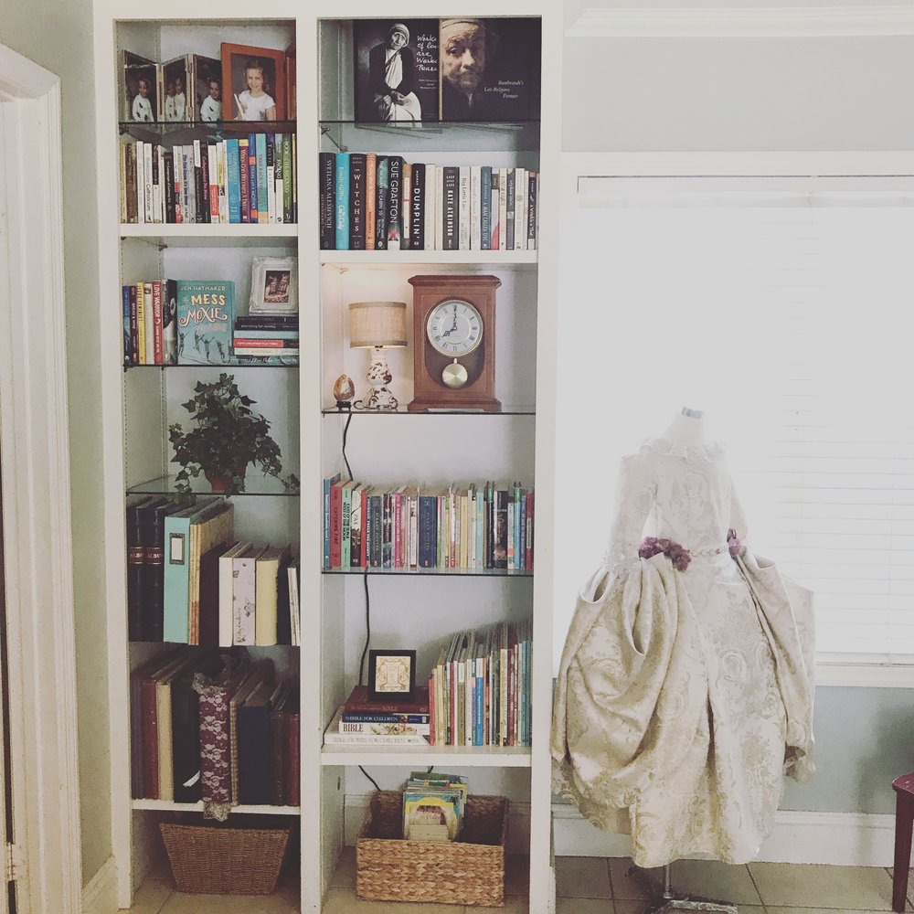 A built-in bookcase in my living room plus the marie antoinette costume i sewed last halloween for my daughter