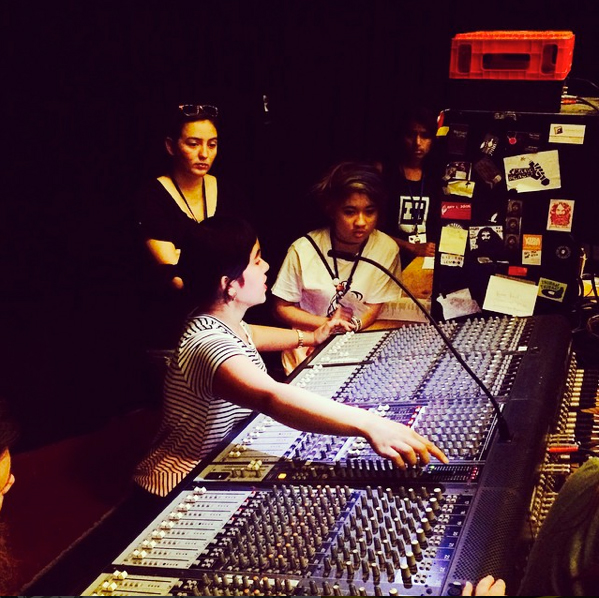 Freelance Audio Engineer Amy Piñon at the sound board.