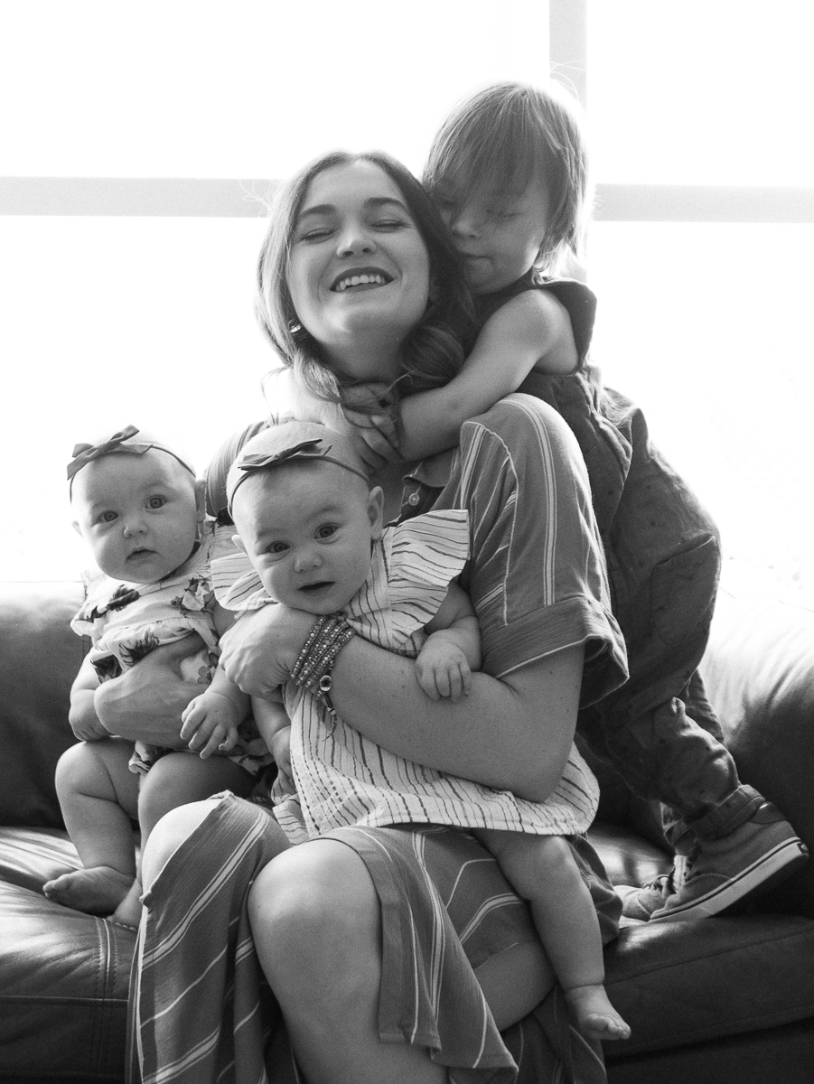 happy mother with three kids