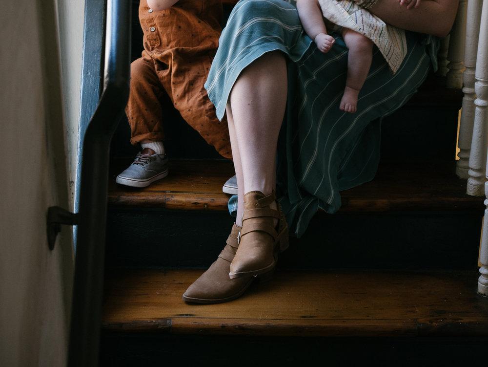 mom's feet with kid's feet