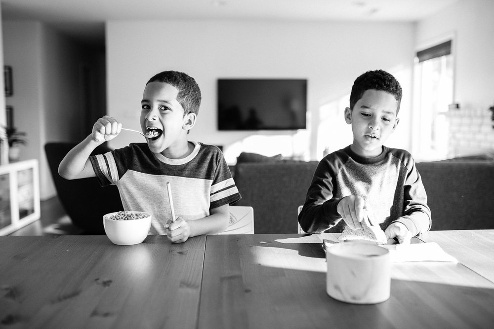twin boys eating breakfast
