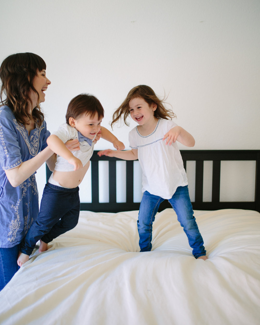 jumping on the bed family session