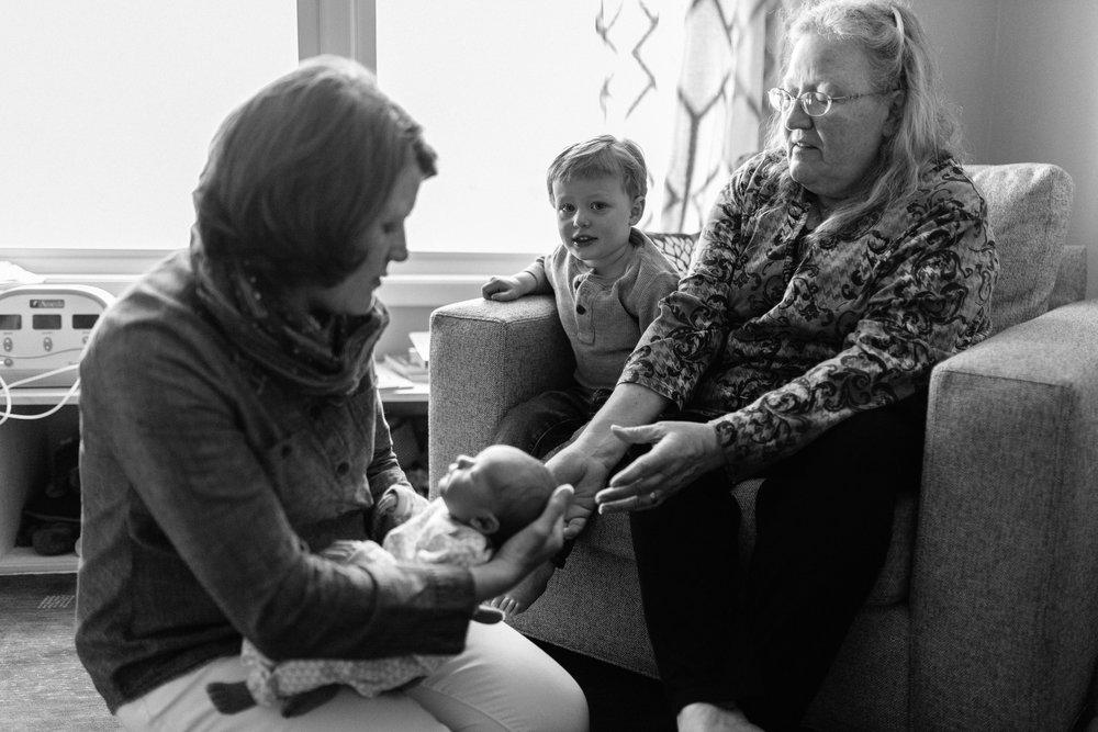 handing baby to grandma