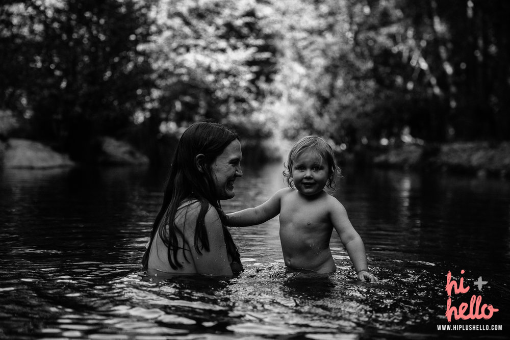 mother and child in the river