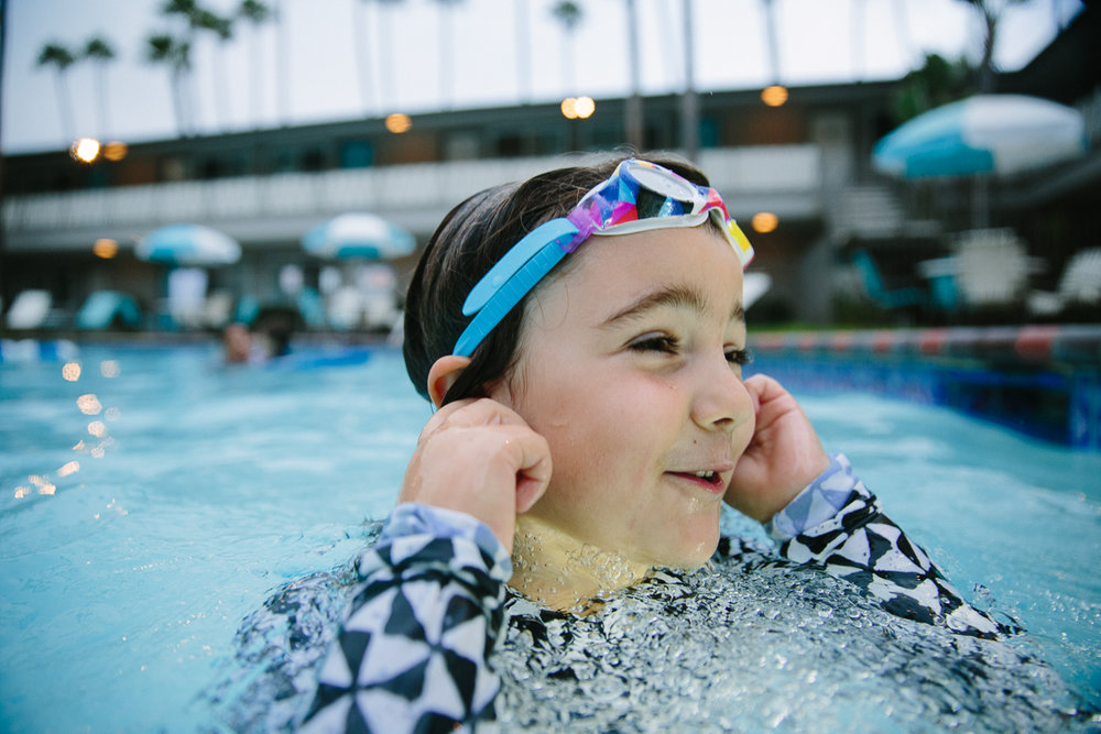 girl in pool with goggles