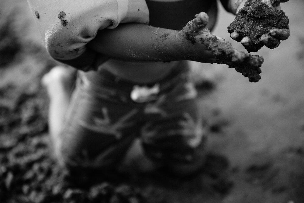 toddler hands sand