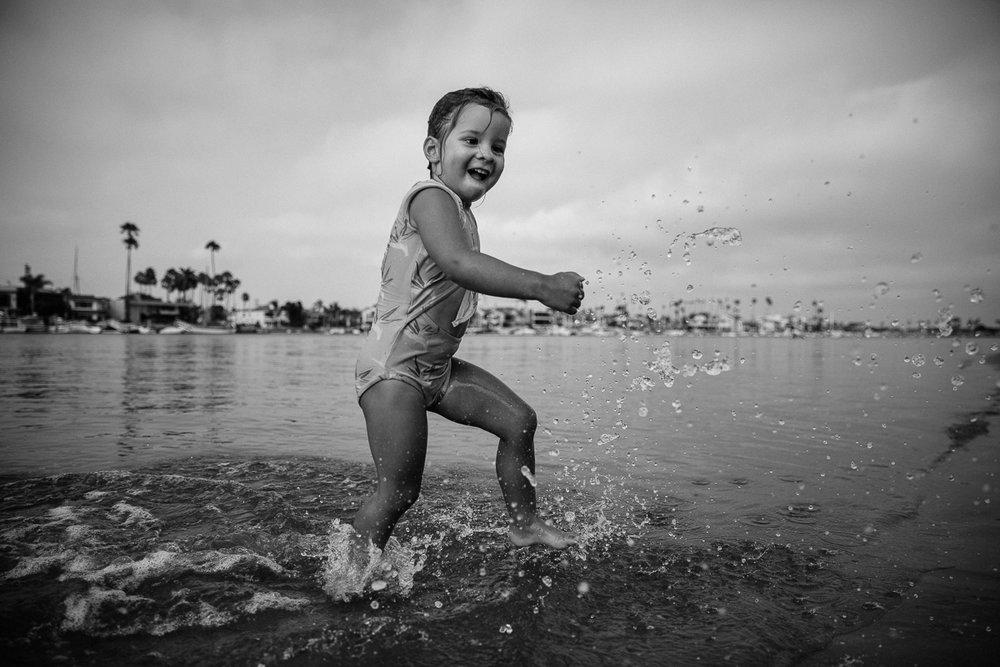 toddler kicking water