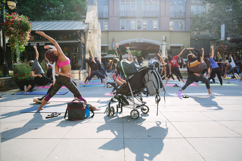 mom doing yoga with stroller
