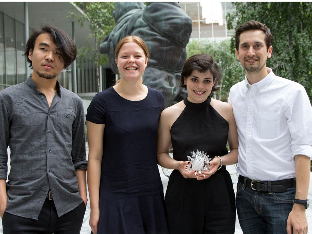 The Team: Gian Cui, Aleksandra Gosiewski, Tessa Callaghan and Aaron Nesser. Advisers (not pictured): Asta Skocir,   T heanne Schiros, Sass Brown, CJ Yeh. Image via  The Fashion Institute of Technology.