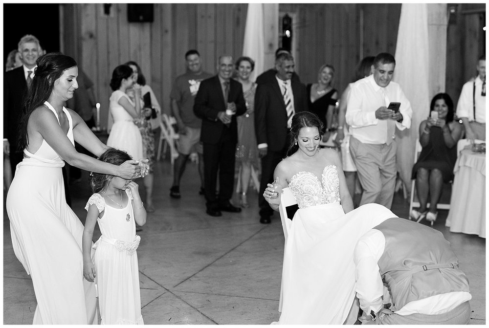 This might be my favorite garter toss shot! Those two to the left are the groom'a sister and niece!