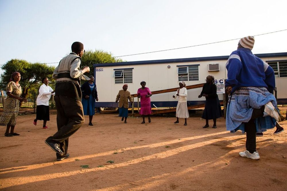 Morning exercise outside the Shoshong Clinic.