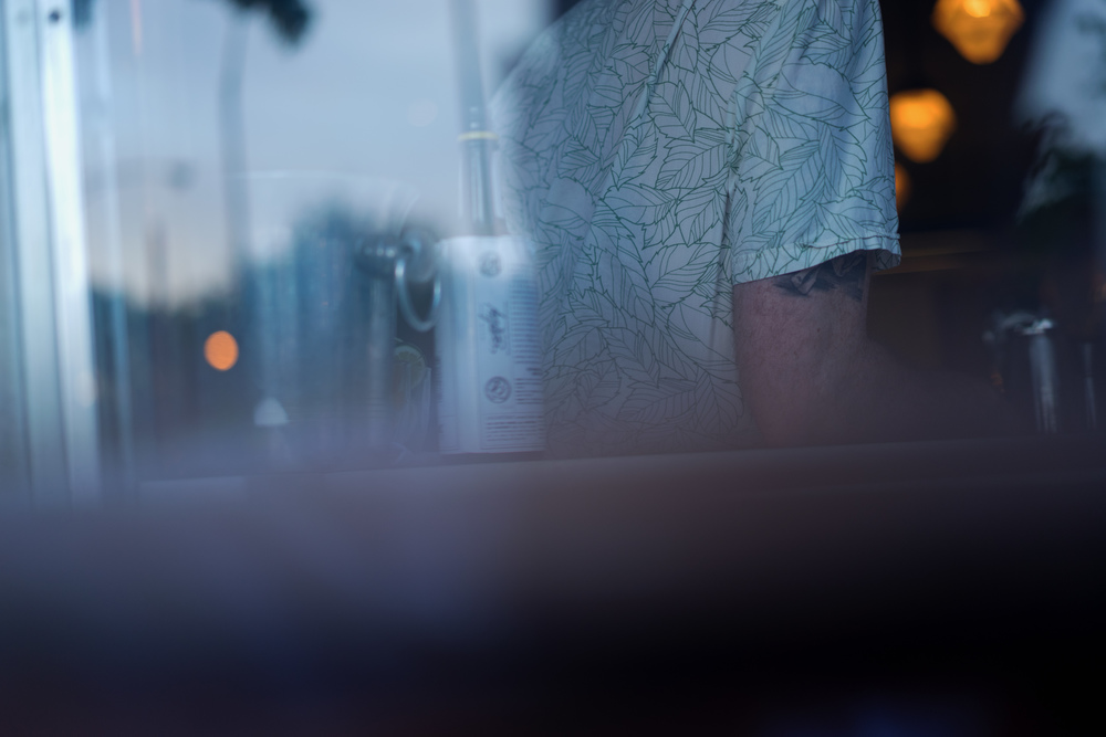Pleasantly surprised with this shot from a restaurant's patio looking through a window at the bartender. f/1.8, 1/60th shutter, ISO 160.