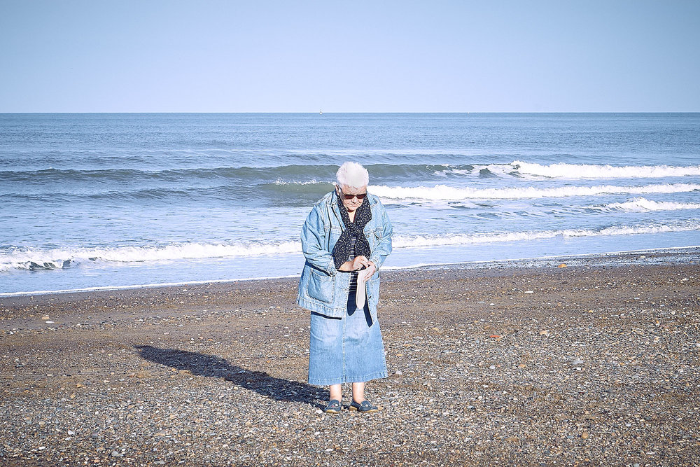 Old lady sea glass collecting, Sandsend.