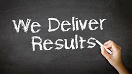 We Deliver Results sign.