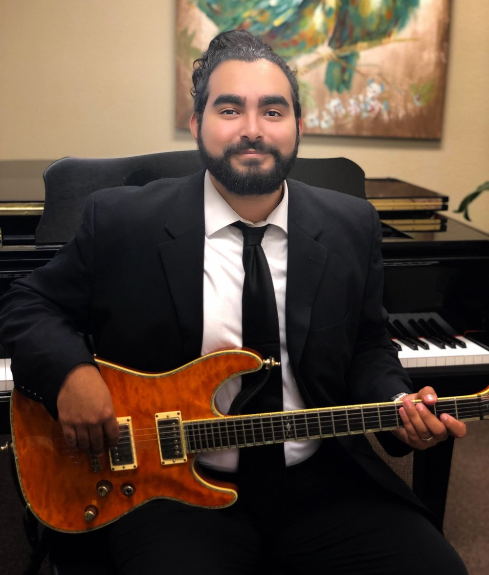 Andres Ojeda-Voice and Guitar