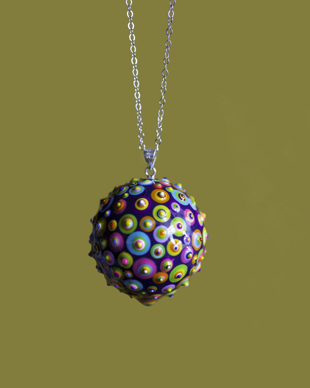 "Bindu Pendant. Purple base. 1-1/4"" Sphere. 28"" Silver chain"