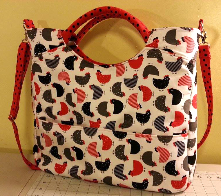 """Part WEEKENDER, part TOTE...designed and sized to be the perfect daily companion. Daytripper (large size) City Tote. Measures 15"""" high, 17"""" wide, and 5"""" deep."""