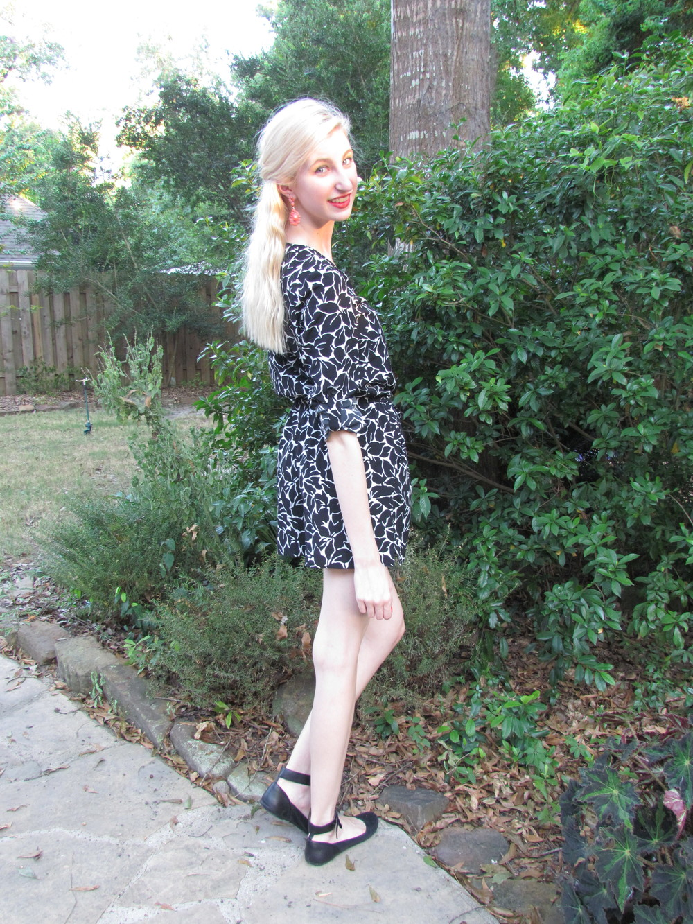 LOFT black and white leaf print romper, coral statement earrings francescas, black ankle-strap flats steve madden, clinique poppy pop lipstick, essie geranium polish