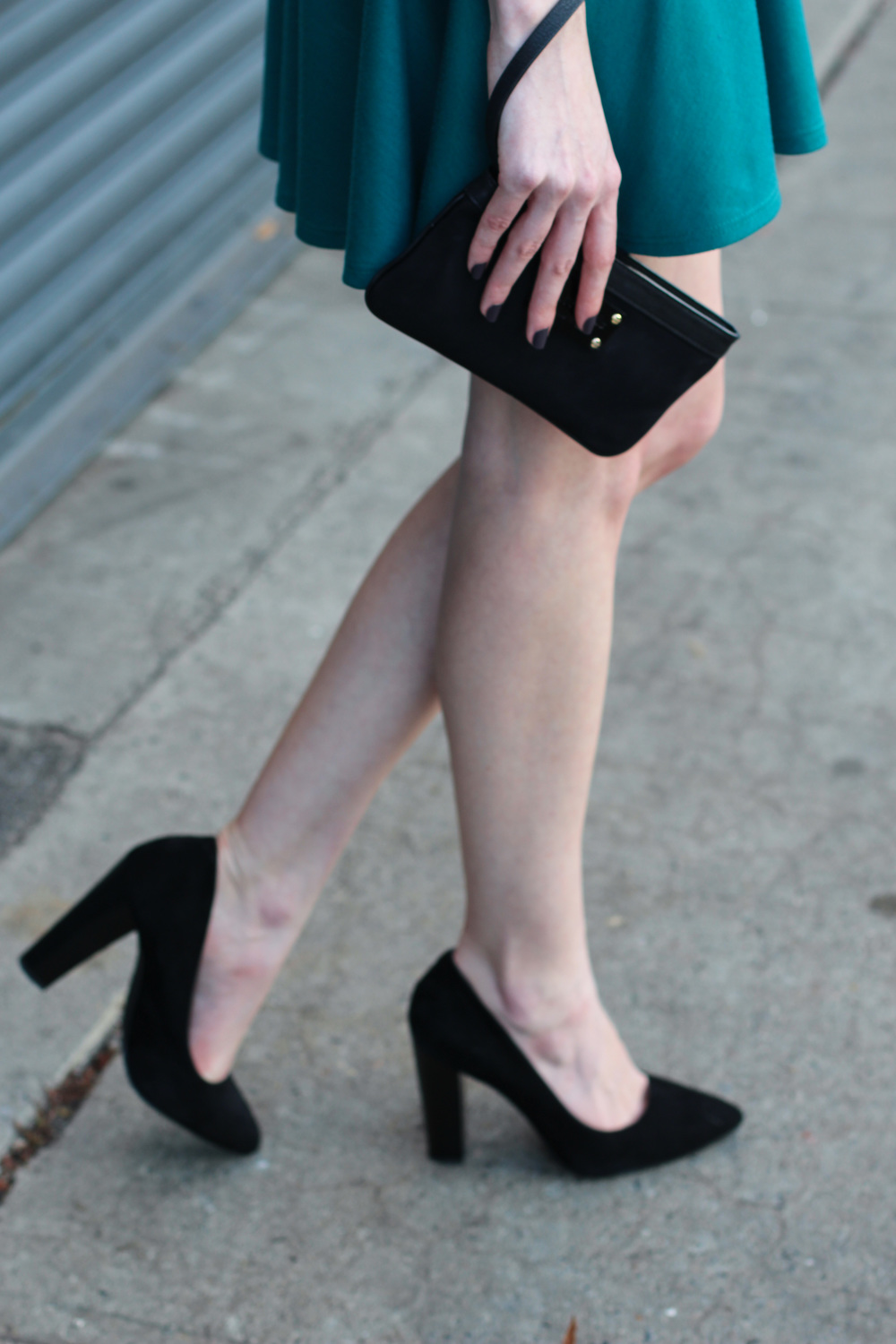 Teal cutout skater knit dress, BCBG pointed toe suede chunky heel black pumps, black Kate Spade wristlet, Clinique Black Honey almost lipstick, braided bun, Essie smokin' hot nail polish