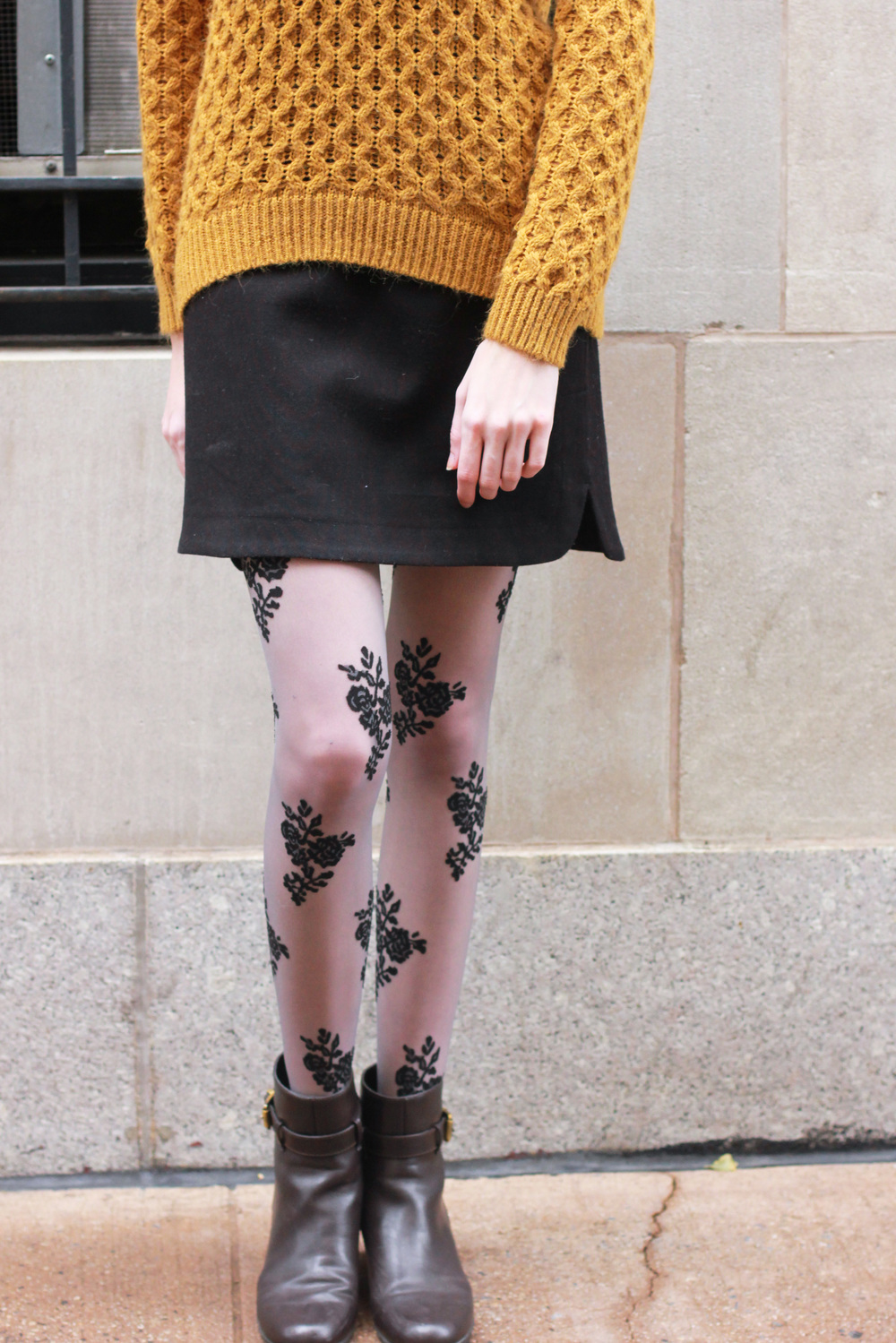 H&M mustard knit sweater, LOFT a-line black skirt, Forever21 lace floral tights, brown leather booties, Henri Bendel leather headband
