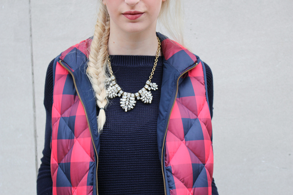 J.Crew Buffalo Check puffer vest, LOFT navy sweater, J.Crew Factory crystal statement necklace, American Eagle jeans, TJ Maxx brown leather booties