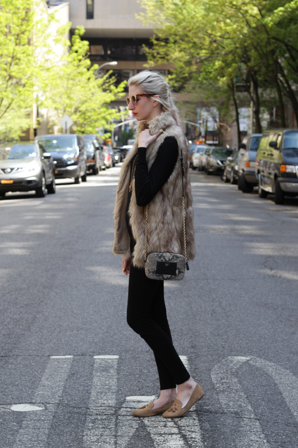 J.Crew snap-front pixie pants, J.Crew crew-neck black sweater, J.Crew Factory Cora tan tassel loafers, brown faux fur vest, diane von furstenberg micro milo crossbody bag, kat von d a-go-go orange lipstick, cat eye and tortoiseshell sunglasses