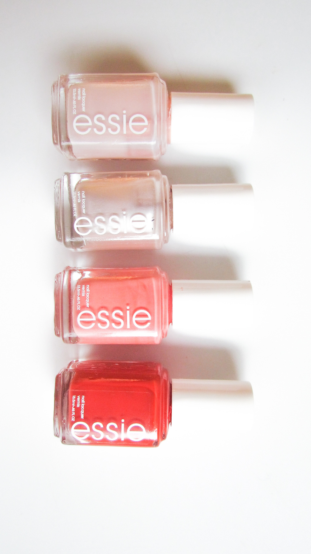 Essie Polishes in Imported Bubbly, Sugar Daddy, Tarte Deco, and Meet Me at Sunset - Southern New Yorker