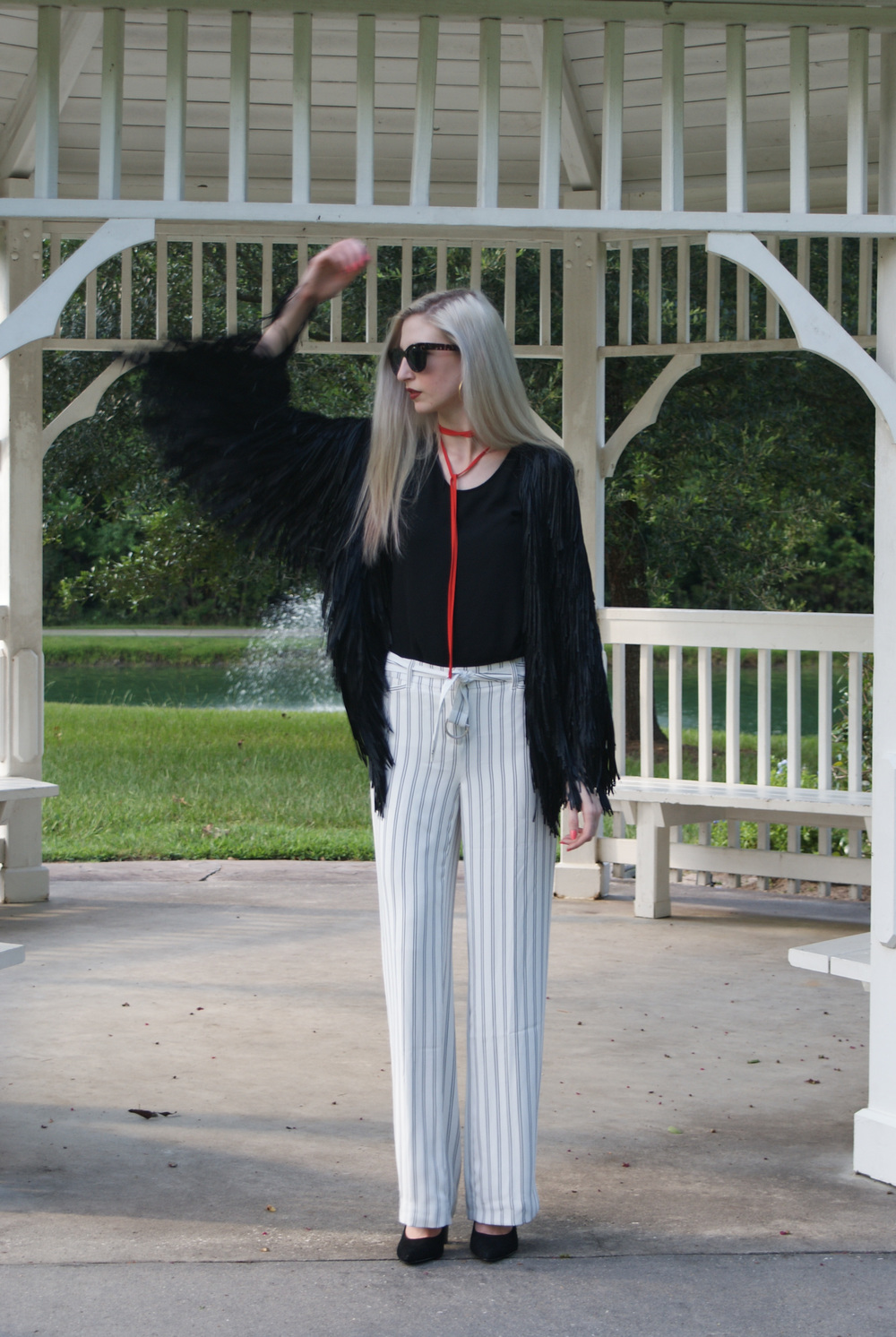LOFT black tee, White House Black Market 70's style wide leg striped pants, pointed toe pump heel, long collar tie necklace, gold hoop earrings, clinique cola pop lipstick, tim ryan fringe jacket