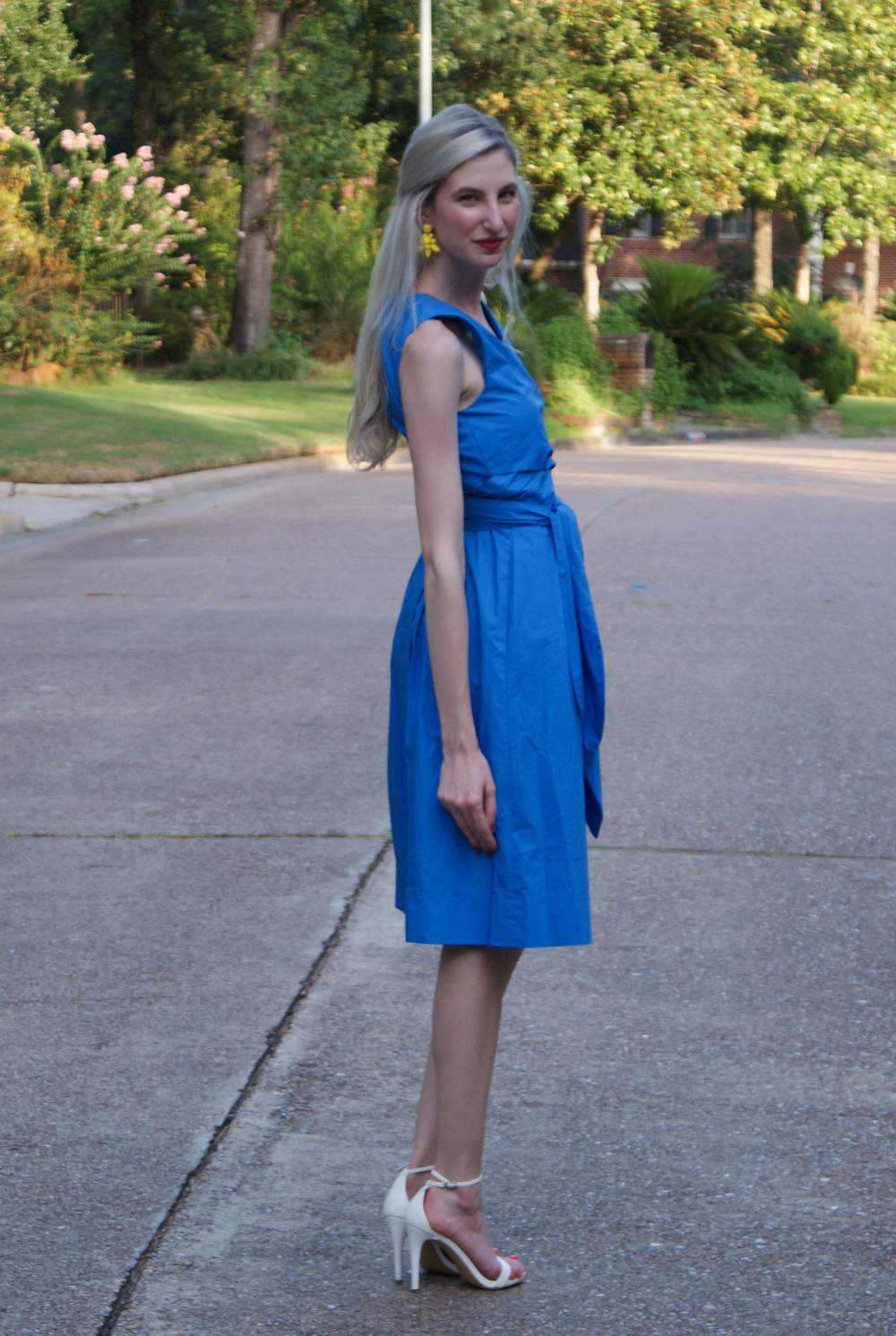 J.Crew blue wrap dress, J.Crew yellow statement earrings, white steve madden stecy ankle strap heeled sandal, kendra scott andy station cuff, revlon ultra hd matte lipstick in devotion