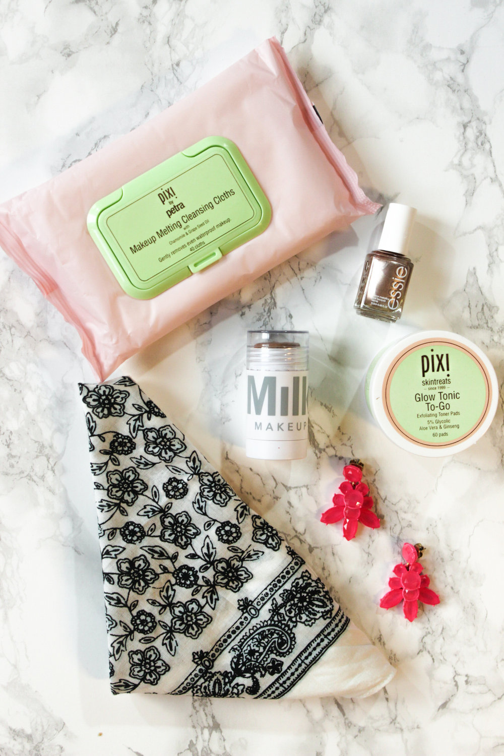 Pixi makeup melting cleansing cloths, pixi glow tonic pads, j.crew bandana, milk makeup cream bronzer, essie penny talk, j.crew statement earrings