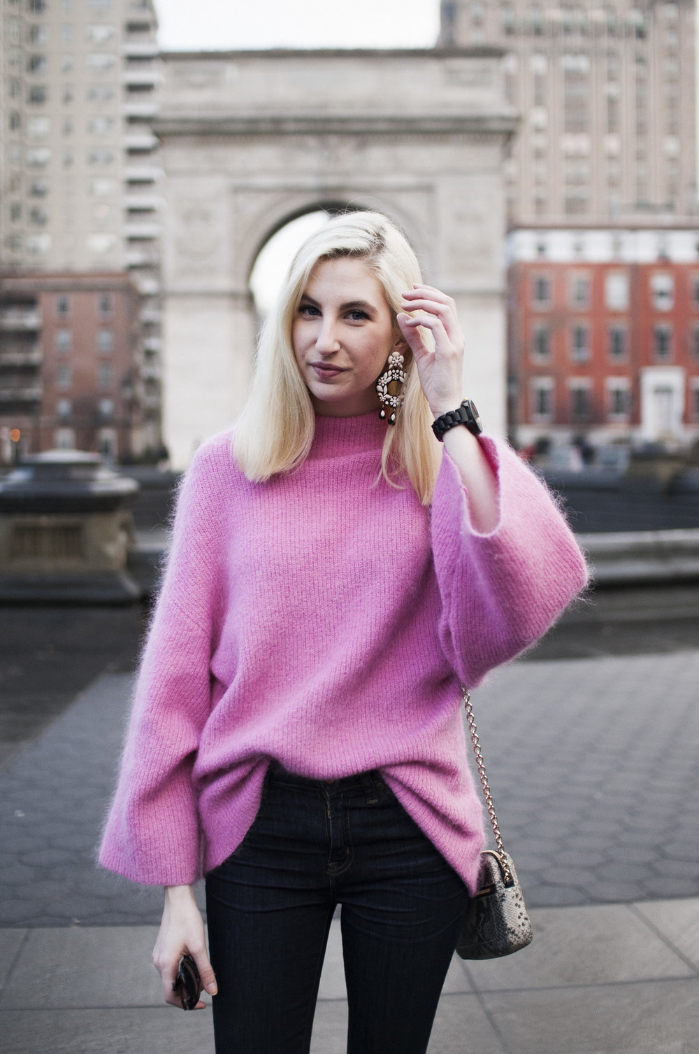 oversized pink mohair mockneck bell sleeve sweater, J.Crew lookout high rise jeans, black block heeled booties, oversized J.Crew tortoiseshell earrings, washington sq park new york city
