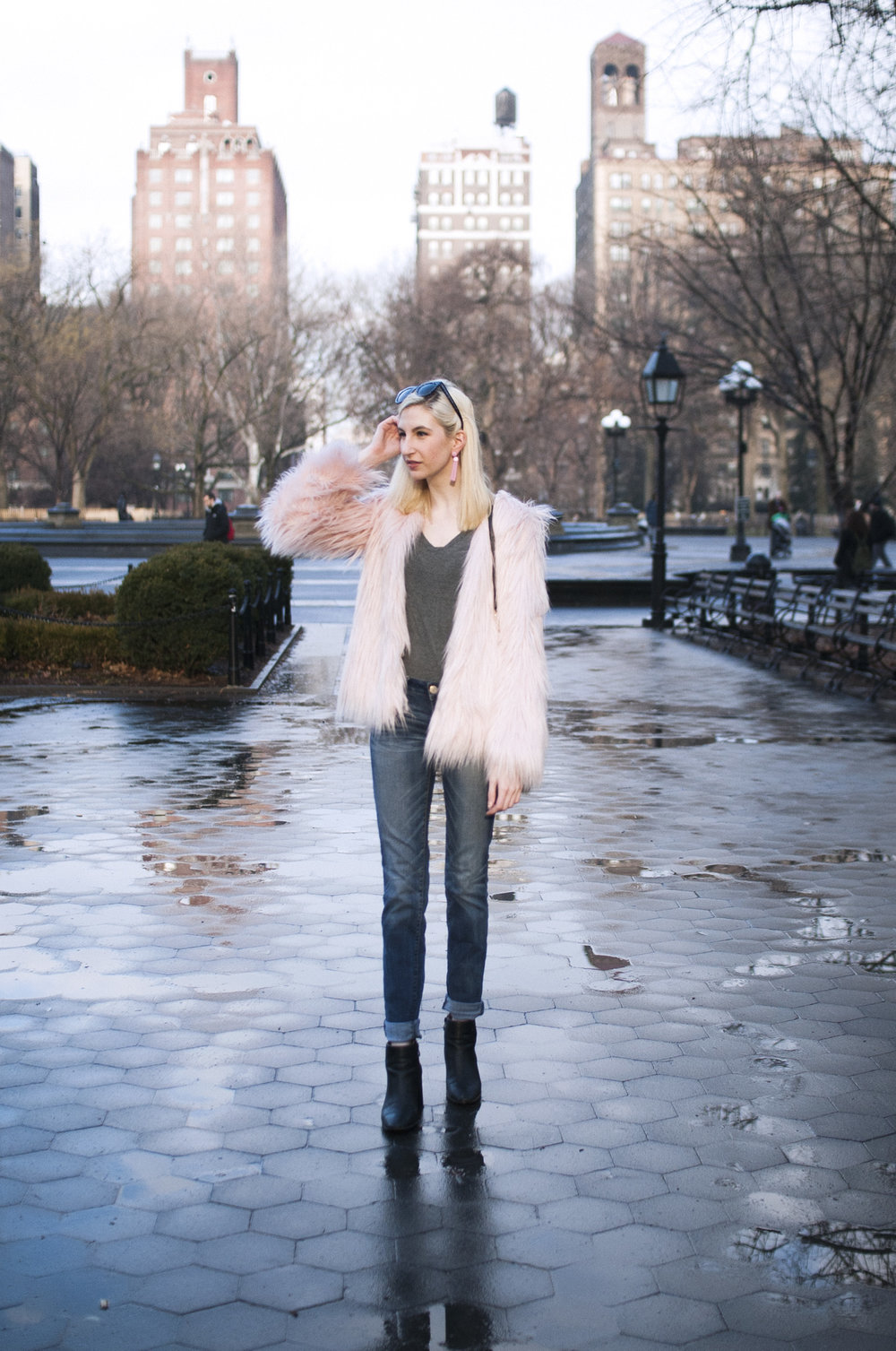 pink faux-fur jacket, relaxed jeans, grey tee, black block heeled booties, pink tassel earrings