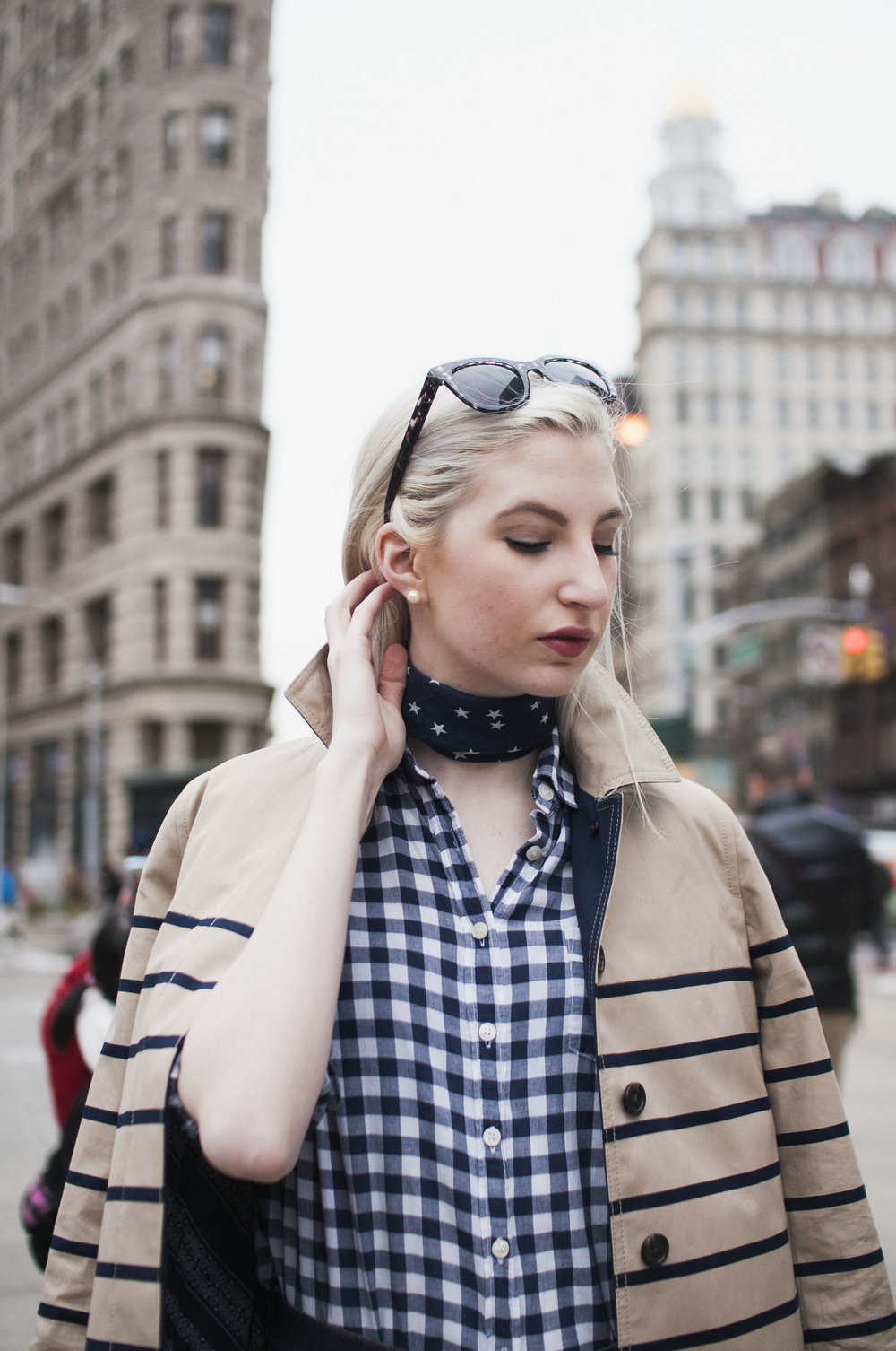 Audra Koch - J.Crew Striped trench, gingham button down, star bandana neck scarf, high waisted jeans, horse loafers, preppy nyc street style