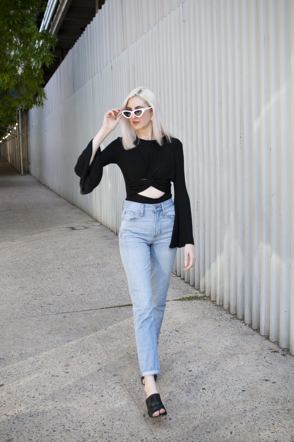 audra koch, mom jeans outfit, boyfriend jeans outfit, cushnie et ochs, bell sleeve top, block heel mules, heeled mule sandals, cat eye sunglasses, white sunglasses, summer outfit inspiration