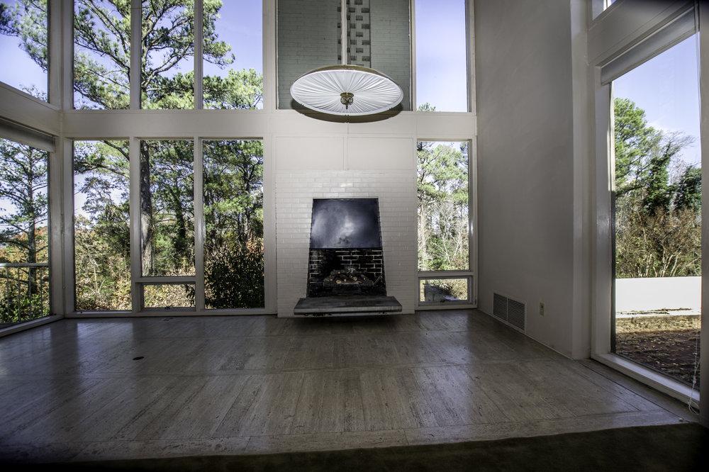 The living room has original travertine flooring.