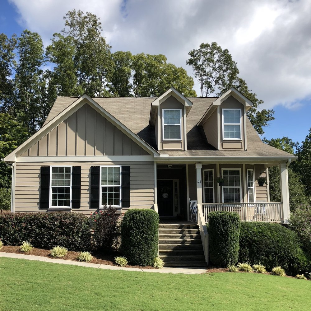 The front of 124 Thornwood Drive oozes Craftsman charm.