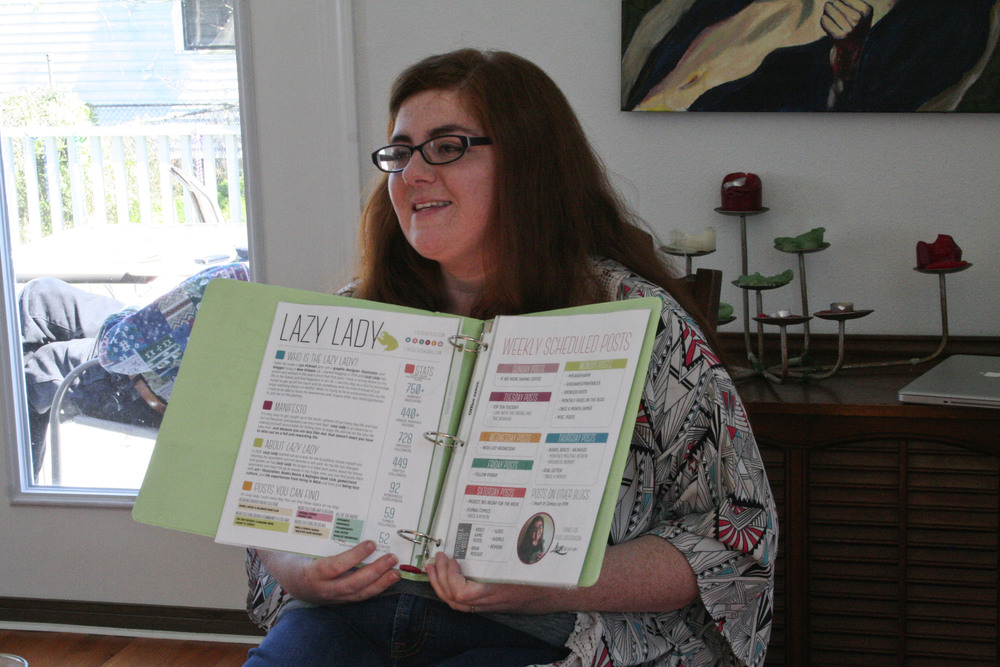 me, showing off my blog planner and media kit. juliet knew i was bringing it and asked me to show it.