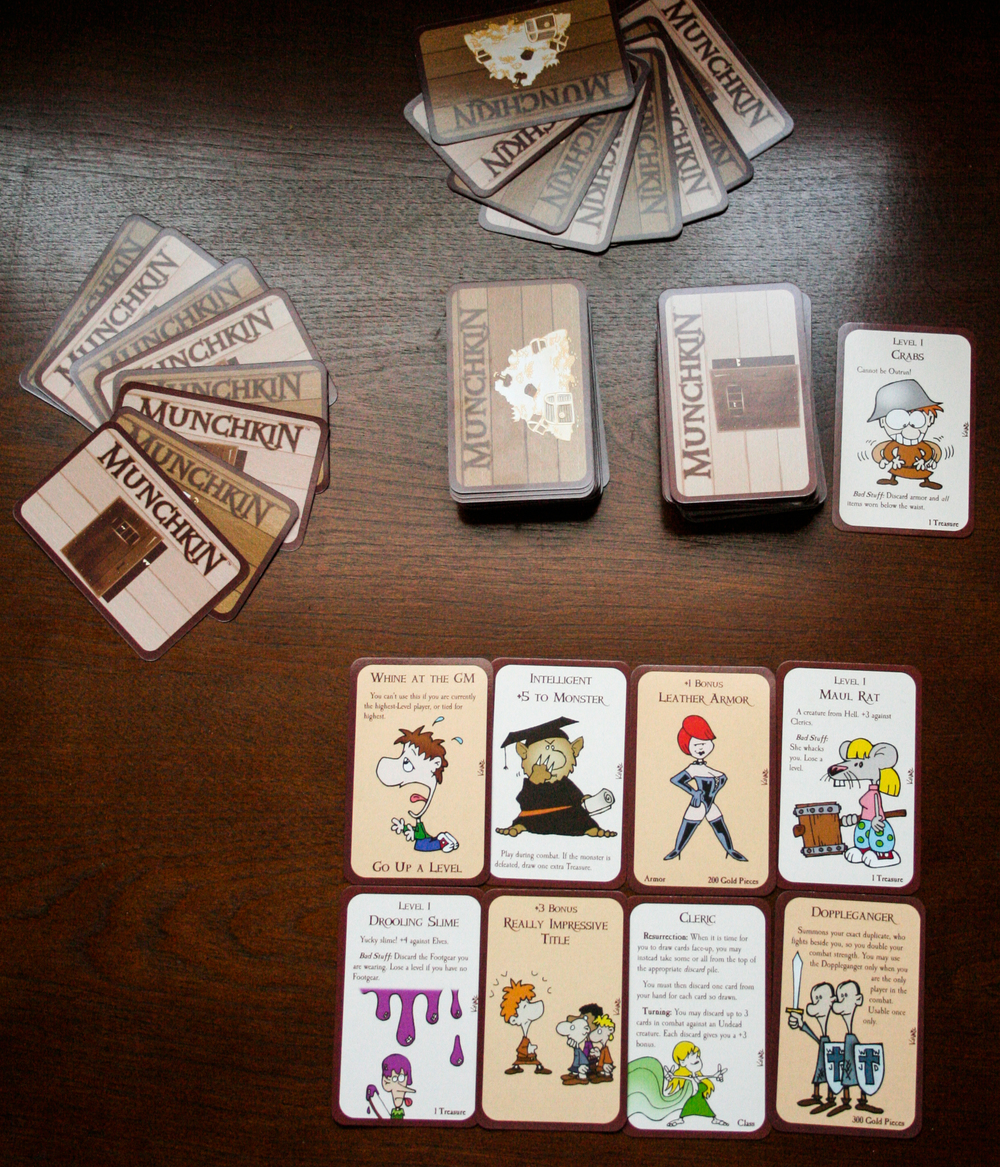 "Here is an example of a game setup. each player starts out with 8 cards, but by the end of your turn, you can only have 5 in your hand. i am showing you ""my"" hand here, so you can see the types of cards that will be in your hand."