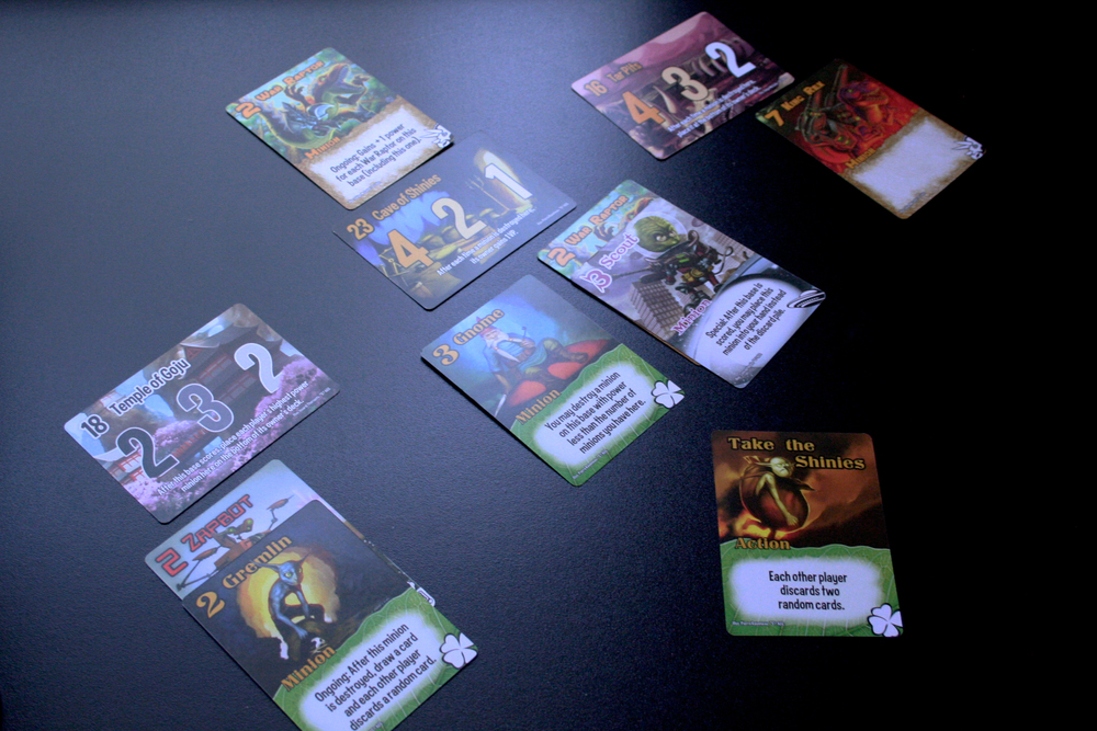 Players play minions and actions to get ahead and break each Base's breaking point number (in the top left on the Base card).
