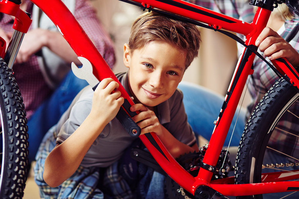 boy repairing bike chaplaincy and refugee story