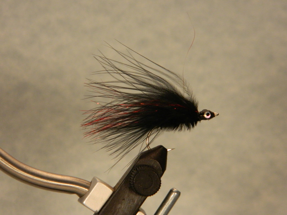 Black,  $3.49 per pair.  The flash is red on this fly.