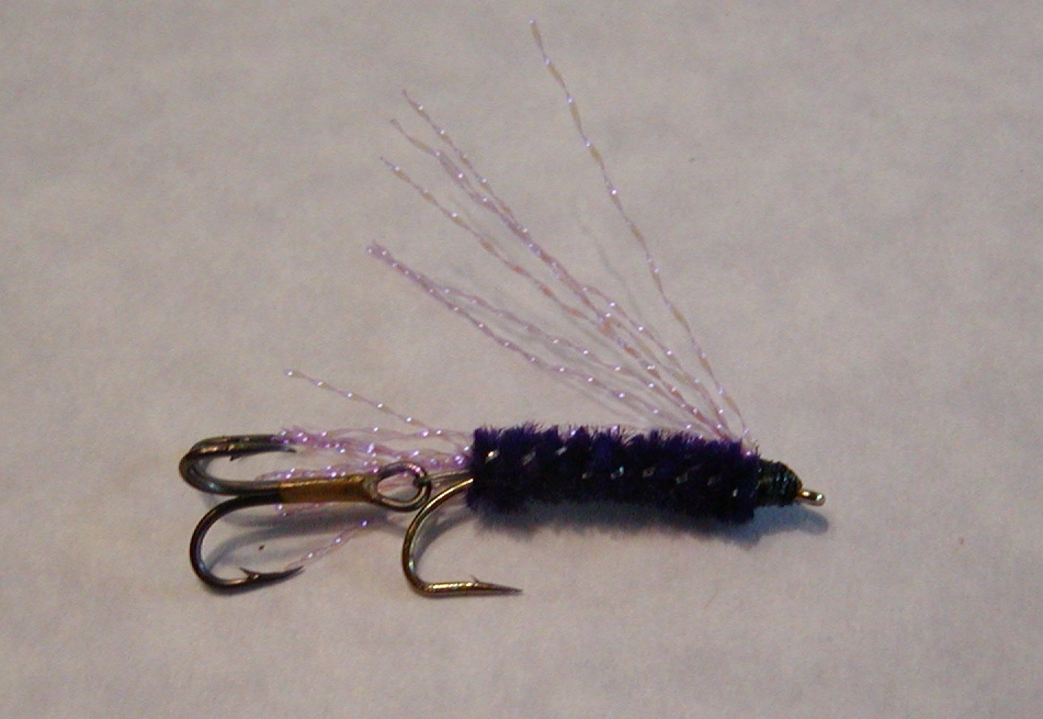 PURPLE KOKANEE FLY:   This fly is a good choice for fishing deep.  Purple retains its color at depth.  It does have UV Purple flash for the wing and tail, as well as a silver core to the body.