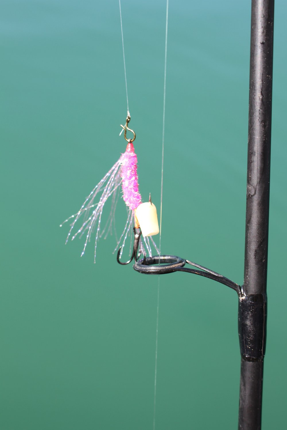 "Typical rig I use when fishing my flies.  A quick change clip to rapidly change colors, ""Shoe Peg Corn"" impaled on the single hook to keep the treble clear for positive hook sets."