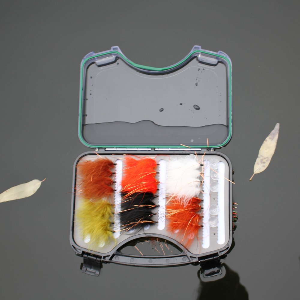 Open fly box floating on water.
